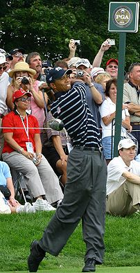 Tiger Woods practicing a day before the 2004 R...