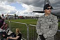 U.S. Air Force Airman 1st Class Andrew Banda, right, a patrolman with the 48th Security Forces Squadron, provides security at a C-130 Hercules aircraft static display during the Farnborough International Airshow 120715-F-RP755-035.jpg