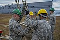 U.S. Airmen with the 52nd Combat Communications Squadron build a ground multiband terminal during Vigilant Shield 15 at the Royal Canadian Air Force 5 Wing at Canadian Forces Base Goose Bay, Newfoundland 141018-F-CR311-530.jpg