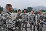U.S. Army 1st Lt. Shane Barnes, a platoon leader assigned to 2nd Battalion, 2nd Combat Aviation Brigade, gives a safety brief to cadets participating in the cadet troop leadership training program with 1st 130808-A-WG463-015.jpg