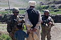 U.S. Army Capt. Alex A. Kaivan, left, the commander of Baker Company, 1st Battalion, 506th Infantry Regiment, 4th Brigade Combat Team, 101st Airborne Division, speaks with residents in Paktia province 130529-A-CW939-034.jpg
