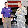 U.S. Army Col. Mark T. Simerly, the commander of the 4th Sustainment Brigade, right, presents a certificate to the University of Mary Hardin Baylor soccer coach Brad Bankhead for his school's support to the unit 130628-A-JI408-001.jpg