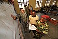 U.S. Army Maj. Jeremy Mitchell, left, reviews notes with a Burundi National Defense Force (BNDF) soldier, right, and his interpreter following a practical exercise during a 10-day civil-military co-operation 140320-F-CU844-165.jpg
