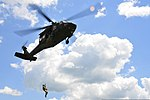 U.S. Army Sgt. Kevin Imhof, a flight medic, is lowered from a UH-60 Black Hawk helicopter during rescue hoist training near the Chesapeake and Delaware Canal in New Castle County, Del., Aug. 4, 2013 130804-Z-DL064-352.jpg