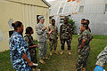 U.S. Army Staff Sgt. Lyle Calder, center, a nurse and combat medic, with 94th Combat Support Hospital, goes over after-action review points, with combat medics, from Belize Defence Force, during a medical 100830-A-CL600-117.jpg