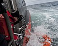 U.S. Coast Guard Boatswain's Mate 3rd Class Amanda Bowles, with the national security cutter USCGC Bertholf (WMSL 750), retrieves a life ring during a simulated man overboard drill on the cutter's small boat 120914-G-VS714-216.jpg