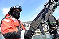 U.S. Coast Guard Fireman Zack Browder, with Coast Guard Station Boston, posts watch on a machine gun mount while conducting security operations in Boston Harbor April 16, 2013, as the Coast Guard increased its 130416-G-XX113-258.jpg