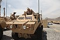 U.S. Marine Corps Sgt. Maj. Bryan B. Battaglia, right, the senior enlisted adviser to the chairman of the Joint Chiefs of Staff, climbs into the driver's seat of a mobile strike force vehicle at the Afghan 130507-A-CL397-090.jpg