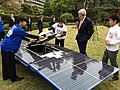 U.S. Secretary of State John Kerry admires a solar-powered car built by members of the Tomodachi Initiative youth engagement program in Tokyo, Japan, on April 14, 2013.jpg