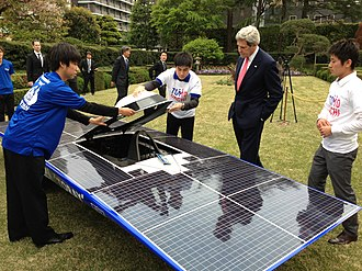 Solar vehicle - U.S. Secretary of State John Kerry admires a solar-powered car built by members of the Tomodachi Initiative youth engagement program in Tokyo, Japan, on April 14, 2013.