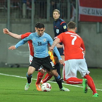 Maxi Pereira - Pereira in action in a friendly against Austria in March 2014