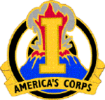 "A gold device containing a gold letter I superimposed over an erupting volcano, with the words ""America's Corps"" at the bottom"