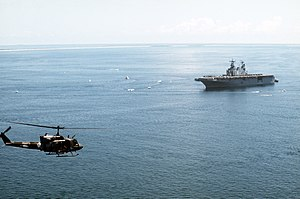 USS Nassau (LHA-4) with UH-1N off North Carolina 1991.JPEG