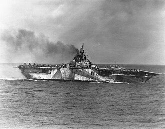 USS Ticonderoga (CV-14) - Ticonderoga listing after kamikaze attacks, 21 January 1945.