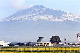 US Navy 030325-N-9693M-001 Sicily's volcano, Mt. Etna, is the backdrop for a U.S. Air Force C-5 and the air terminal of Naval Air Station (NAS) Sigonella.jpg