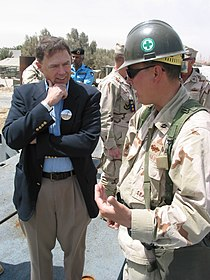 US Navy 030403-N-1050K-021 From left, the Honorable Richard H. Jones, U.S. Ambassador to the State of Kuwait, listens while Lt. Cmdr. Timothy Cowan, Operations Officer for Amphibious Construction Battalion Two (ACB-2).jpg