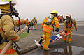 US Navy 030604-N-0000W-002 Firefighters from Commander, Naval Forces Japan Regional Fire Department are first on the scene, to assist simulated casualties during a helicopter crash training exercise.jpg