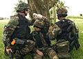 US Navy 040212-N-7293M-081 Members of Mobile Security Squadron Seven assist a simulated casualty off the battlefield during an urban terrorism training exercise.jpg
