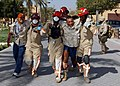 US Navy 040303-N-8955M-002 Emergency Response Team (ERT) personnel carry victims away from a simulated bomb explosion during Exercise Desert Sailor 2004 at Naval Support Activity Bahrain.jpg