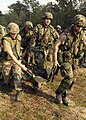 US Navy 041027-N-5526M-008 Seabees assigned to Naval Mobile Construction Battalion One (NMCB-1), participate in a mass casualty drill during field exercise Operation Gulf Mist at Camp Shelby, Miss.jpg