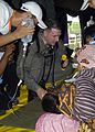 US Navy 050103-N-9951E-100 Lt. Mark Banks, of Savannah, Ga., tends to a patient flown-in by a U.S. Navy helicopter to a temporary triage site in Aceh, Sumatra.jpg