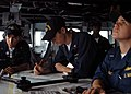 US Navy 050316-N-7526R-079 A team of watch standers on the bridge of USS Blue Ridge (LCC 19) check the plotting charts and set the course for the their departure from Manila Bay, Philippines.jpg