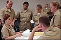 US Navy 050516-N-2000D-022 Lt. Rebecca Summers, navigation instructor at the Naval Science Institute (NSI) gives Officer Candidate Lisa Lee and her team post-analysis after a simulated navigation brief.jpg