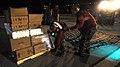 US Navy 050906-N-6403R-024 U.S. Navy Aviation Ordnancemen Airman Kyle Baker and Kenith Mitchell organize supplies aboard the amphibious assault ship USS Iwo Jima (LHD 7) during a vertical replenishment.jpg
