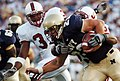 US Navy 050910-N-9693M-002 U.S. Naval Academy Midshipmen fullback Adam Ballard is tackled by Stanford Cardinal linebacker Michael Okwo.jpg
