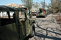 US Navy 050911-N-9712C-001 A U.S. Navy Seabee convoy makes its way through the streets of New Orleans as part of Hurricane Katrina relief efforts.jpg