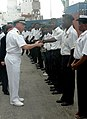 US Navy 070220-N-4657D-003 Captain John Nowell, commander, Destroyer Squadron Six Zero, shakes hands with an Angolan sailor.jpg