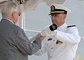 US Navy 070310-N-9909C-002 Retired Senior Chief Fire Control Technician Hank Wristen, passes the ship's long glass to Chief Warrant Officer Robert McLaughlin.jpg