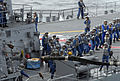 US Navy 070317-N-7730P-217 Sailors aboard Japan Maritime Self Defense Force (JMSDF) ship JS Myoko (DDG 175) pull the messenger line to set a fuel probe during a mock fueling at sea (FAS) exercise with Nimitz-class aircraft car.jpg