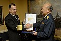 US Navy 070404-N-0696M-043 Chief of Naval Operations (CNO) Adm. Mike Mullen presents Chinese People's Liberation Army Navy Commander-in-Chief Adm. Wu Shengli with a commemorative plaque.jpg