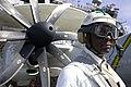 US Navy 070625-N-8591H-023 Aviation Ordnanceman 1st Class Adrian Harp watches flight operations as a safety supervisor on board USS Kitty Hawk (CV 63).jpg
