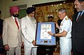 US Navy 070703-N-4420S-122 Commander, Carrier Strike Group Eleven, Rear Adm. Terry Blake, presents a framed lithograph of the Strike Group to the Governor of Chennai, India.jpg