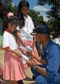 US Navy 071016-N-6710M-137 Cmdr. Todd A. Lewis, commanding officer of the USS Tortuga (LSD 46), interacts with the students of Gordon Heights Elementary School while conducting a community relations project in the Republic of P.jpg