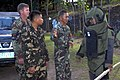 US Navy 071210-N-7286M-086 Members of U.S Navy Explosive Ordnance Disposal Mobile Unit (EODMU), Det. 7 deliver an SRS-5 light weight explosive protection suit during training with member's of the Armed Forces of the Philippines.jpg