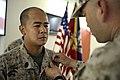 US Navy 080916-M-4937G-057 hief Hospital Corpsman Victor Isarraraz right, pins Chief Hospital Corpsman Norman A. Manglicmot.jpg