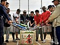 US Navy 081025-N-0807W-097 Members of the Fleet Activities Sasebo Security Detachment exchange bows with their Japanese counterparts.softball team the.jpg