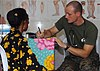US Navy 091016-N-8829H-119 Lt. Stephen Zanoni conducts a medical interview with a patient during a medical civic action program supporting Marine Exercise (MAREX) 2009.jpg