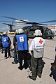 US Navy 100122-N-7456N-085 American Red Cross volunteers board an MH-35E Sea Dragon helicopter bound for Haiti.jpg