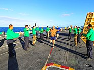 US Navy 100217-N-2953W-103 Sailors assigned to the V-2 division of the air department aboard the aircraft carrier USS Carl Vinson (CVN 70) cheer as Canadian Army chaplain Rory Macdonald runs aboard the nuclear-powered aircraft