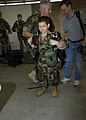 US Navy 100429-N-0683T-080 A little boy tries on a free-fall parachute rig with help from a Sailor assigned to Naval Special Warfare Group (NSWG) 2 as part of his Make-A-Wish request.jpg