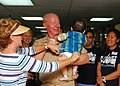 US Navy 100608-N-4044H-005 Adm. Robert F. Willard, commander of U.S. Pacific Command, holds a Vietnamese child during his visit to the pediatric ward aboard the Military Sealift Command hospital ship USNS Mercy (T-AH 19).jpg