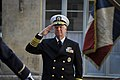 US Navy 100719-N-8273J-008 Chief of Naval Operations (CNO) Adm. Gary Roughead salutes during the playing of the U.S. national anthem during a welcoming ceremony at the French Navy Headquarters in Paris.jpg