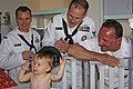 US Navy 100820-N-3038C-001 Command Master Chief Dave Bisson and area Sailors present a Navy ball cap to a patient at St. Luke's Children's Hospital during Boise Navy Week.jpg
