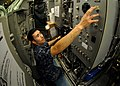 US Navy 101013-N-7705S-020 Machinist's Mate 1st Class Alberto Lezama, from New York, switches the number one carbon dioxide scrubber into recircula.jpg
