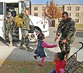 US Navy 101216-N-7084M-255 A Seabee assigned to Naval Mobile Construction Battalion (NMCB) 7 is welcomed home by his daughter during a homecoming c.jpg