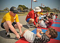 US Navy 110316-N-AW702-001 oatswain's Mate Seaman William Spellman, assigned to harbor operations at Naval Station Mayport, helps a Kindergarten st.jpg